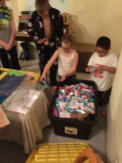 Cavanaugh kids preparing a box full of soap, art supplies, toothpaste, etc, for the Children's Home here in Honduras.  Jason and Jessica will be personally delivering it