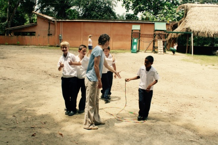 Recess, the 4th grade boys playing jump rope with Ashley